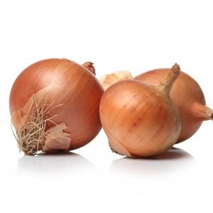 raw onions white surface
