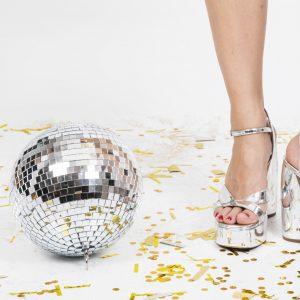 woman legs high heels disco ball