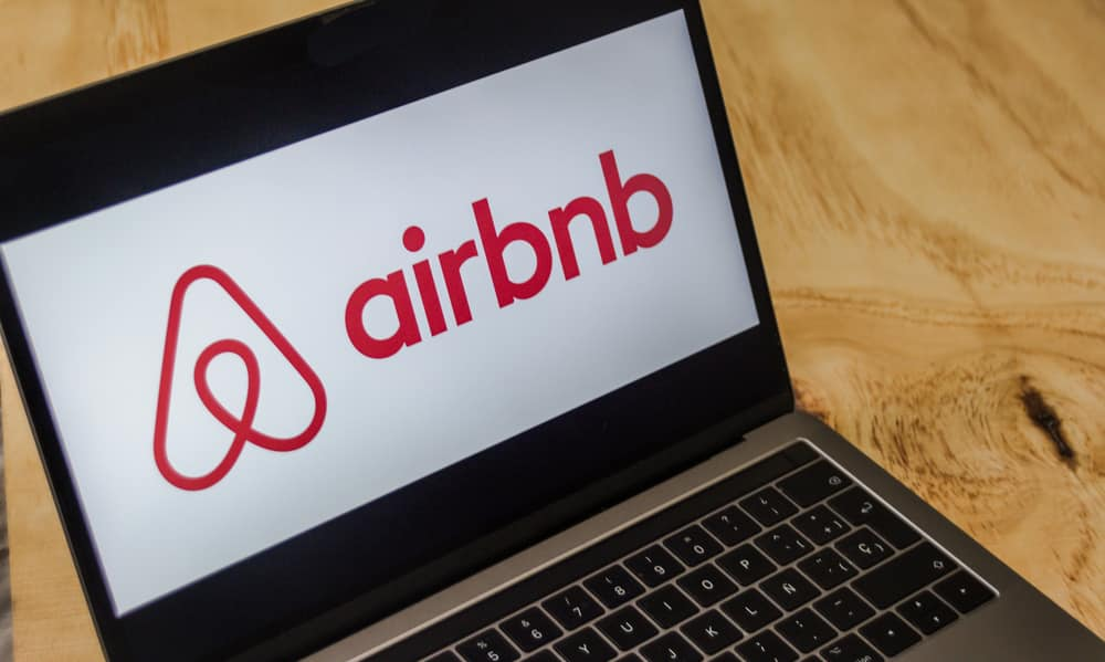 airbnb-photo of laptop with airbnb on the screen in red letters