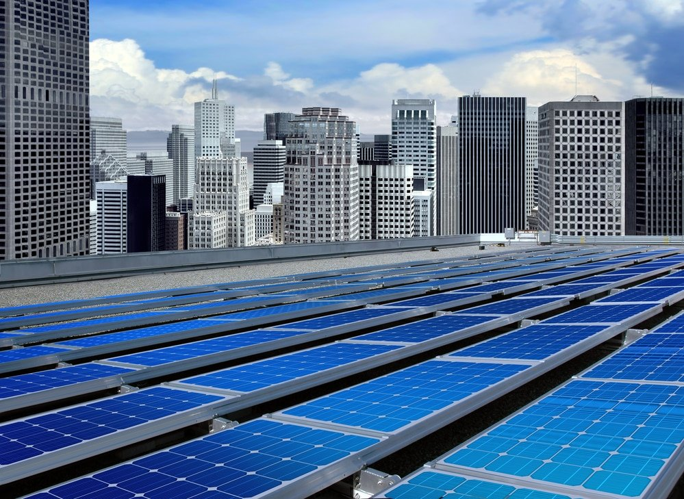 Alternative investments - photo of solar panels on roof of a skyscraper