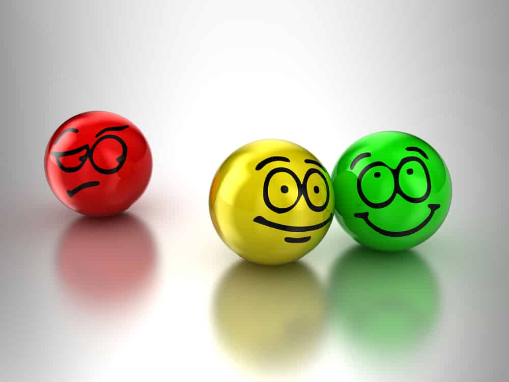 envy vs. jealousy- animation of a red found ball with a frowny face loking at a yellow and green ball beside each other with happy faces