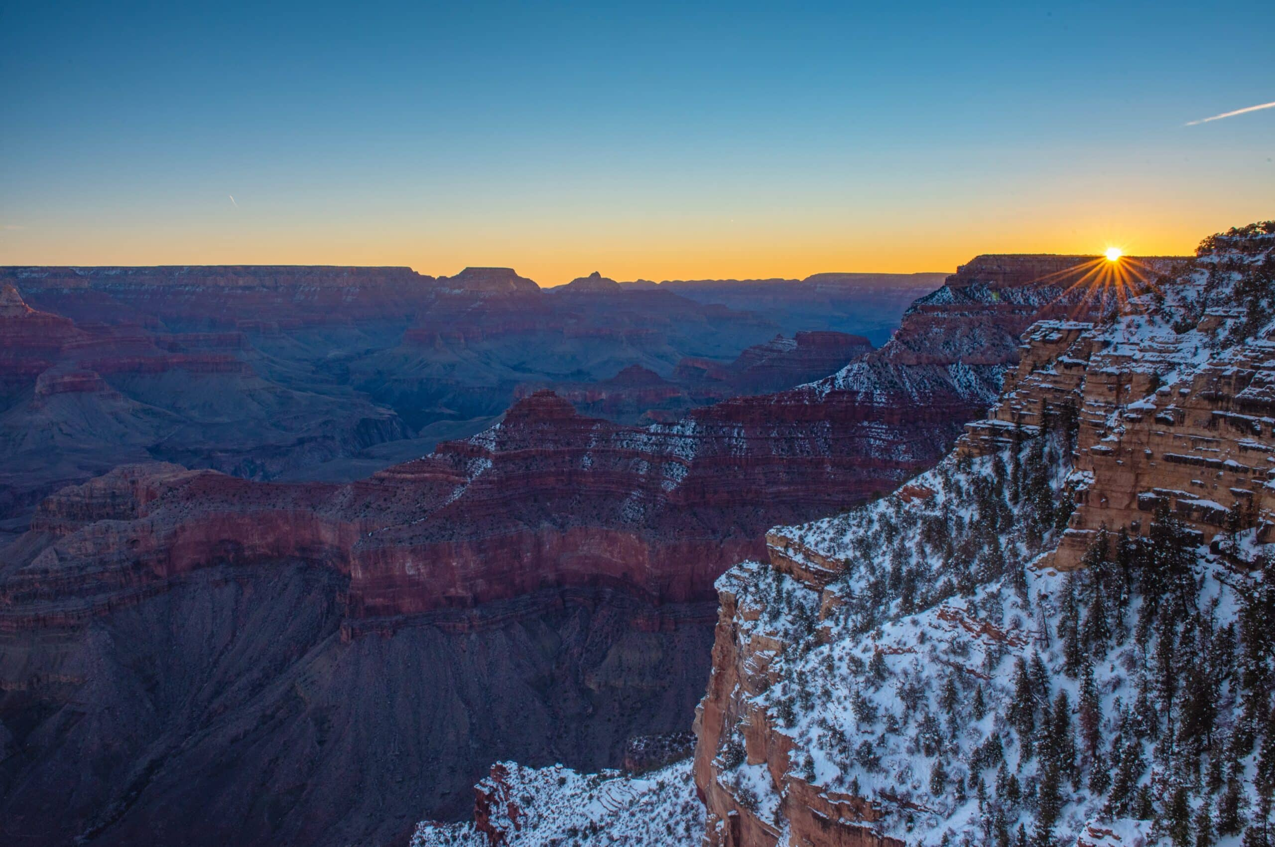 grand canyon with snow on peaks
