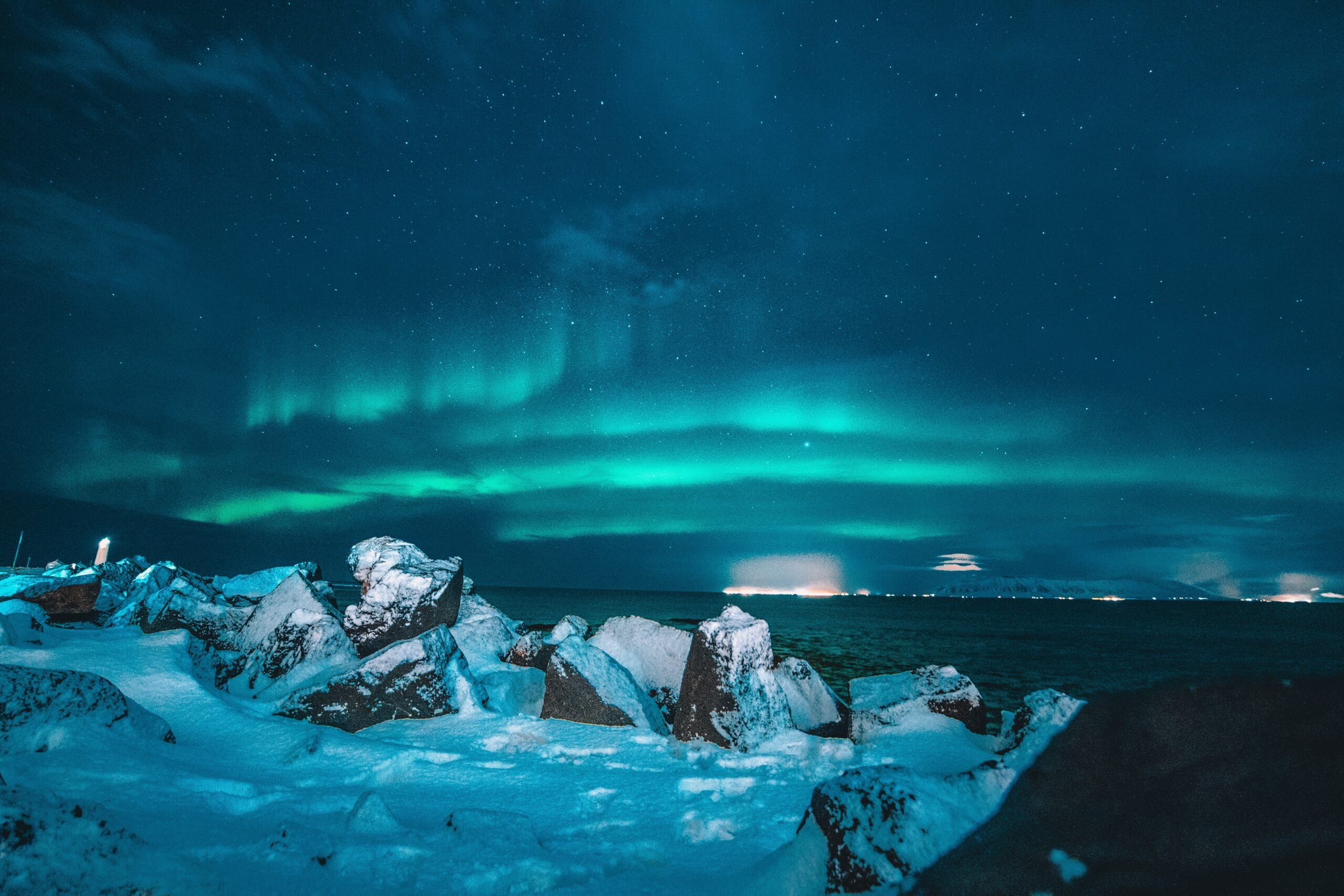 northern lights with snow on the ground