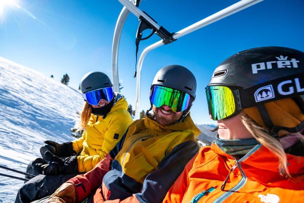 people on ski lift unsplash
