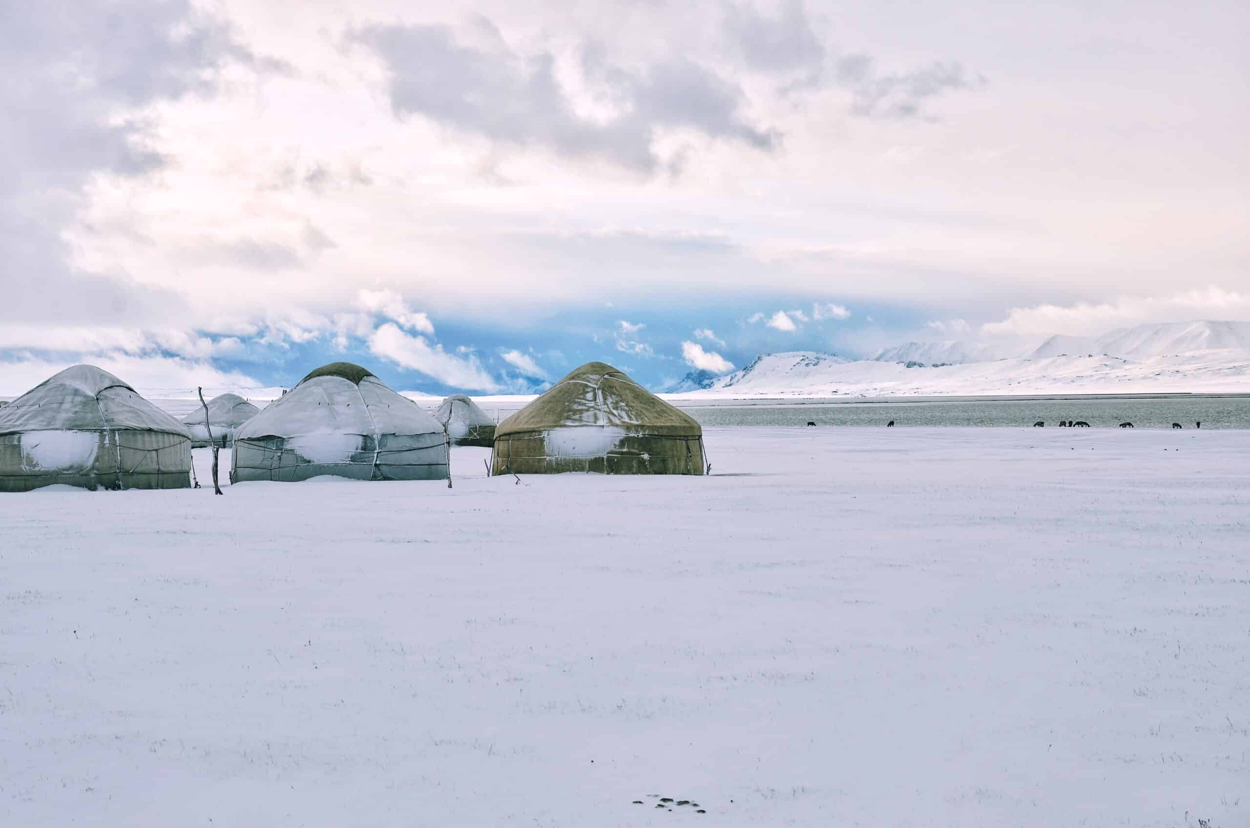series of yurts in the snow